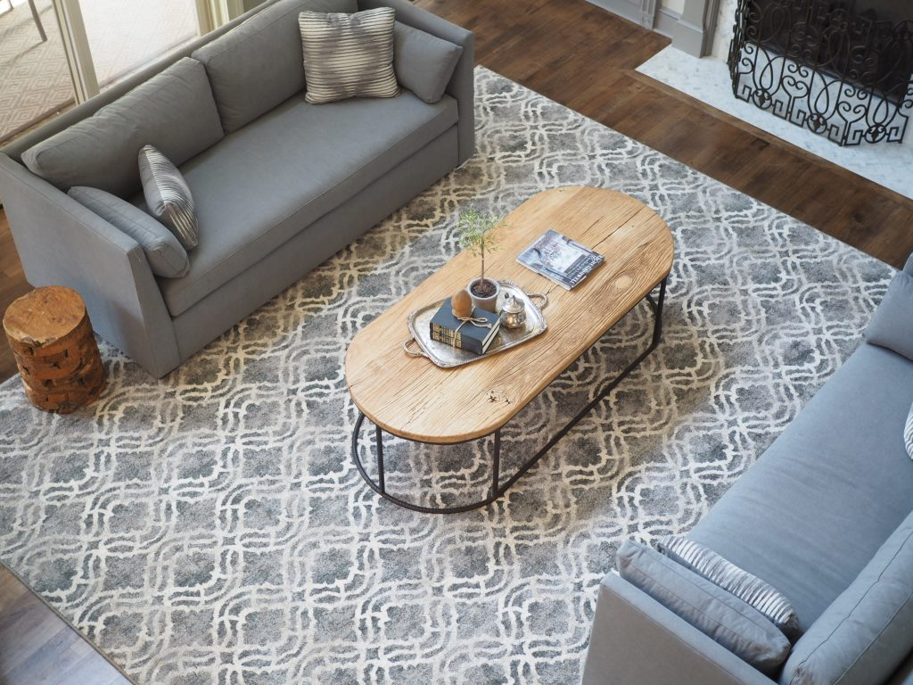 A Custom Rug Helps To Define An Oversized Family Room